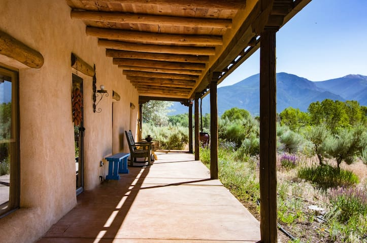 Unique adobe home on 6 acres with 360-degree views, just 20 minutes from Taos Ski Valley