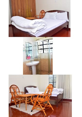 A room with a double  bed for 2 With private birthroom with hot shower, a comfortable chair and a table @ $30