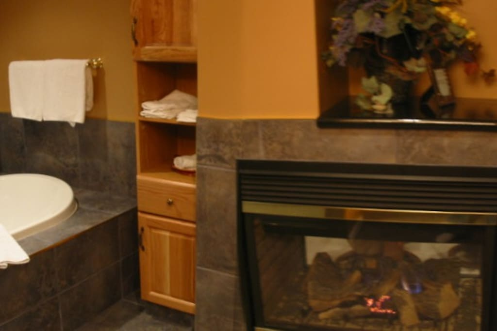 Fireplace gives the private bathroom that extra special touch.