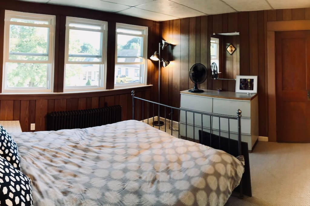 Main bedroom 1/3 with queen sized bed and large, cedar walk-in closet.