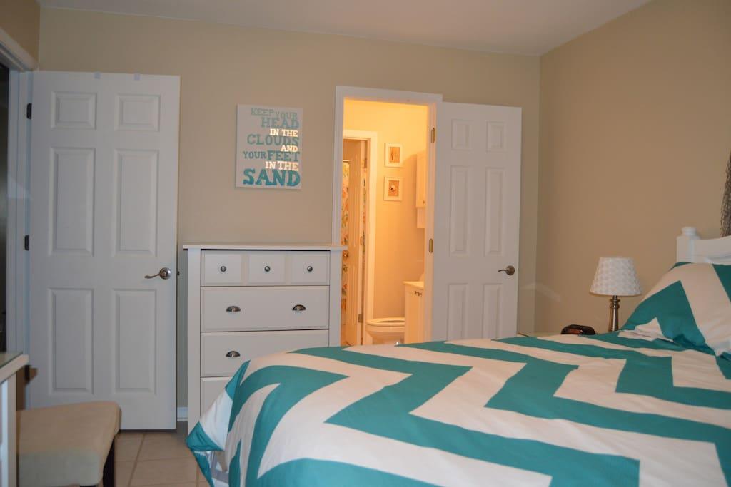 Bedroom looking into 1/2 bath