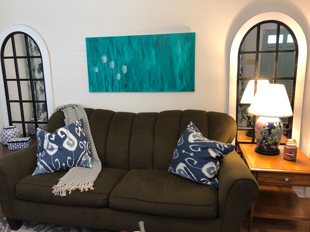 Sit back and watch cable tv or Netflix on the flat screen tv on the comfy sofa.