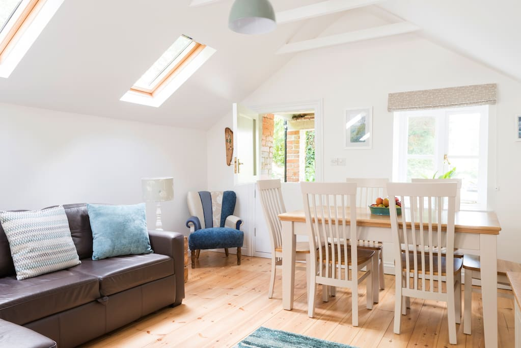 The upstairs, open plan living/dining area