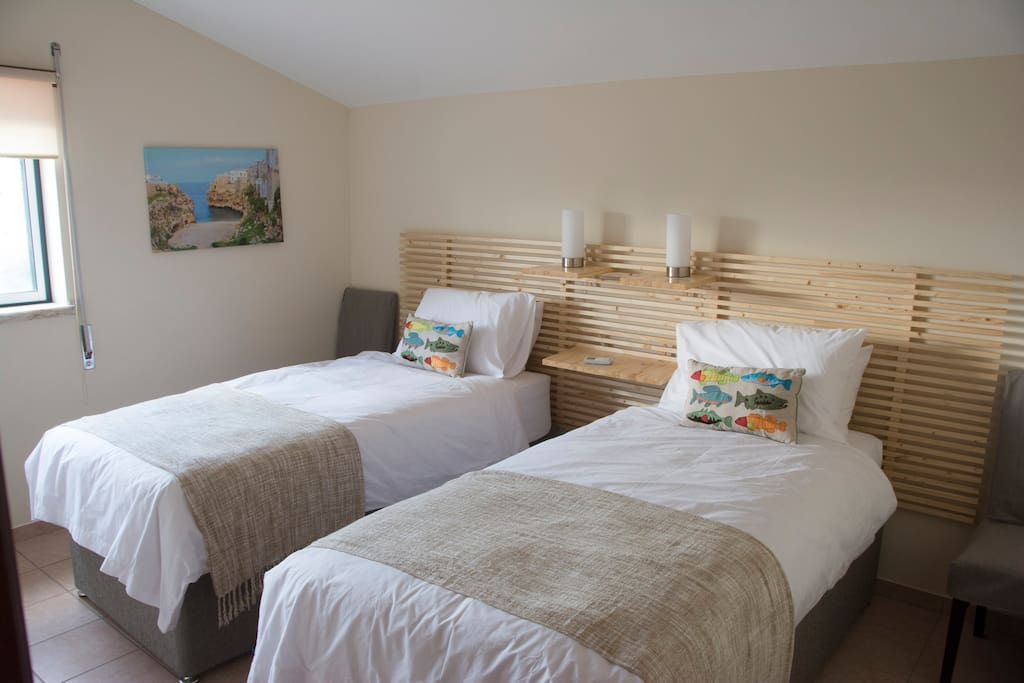 Beds in both bedrooms can be configured as king or singles