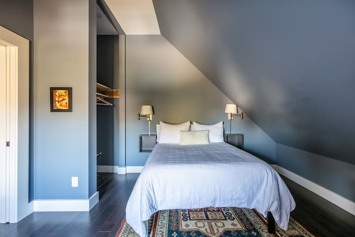 Our guests tell us that this master bedroom has the most comfortable mattress and that they love the blackout blinds on the window.