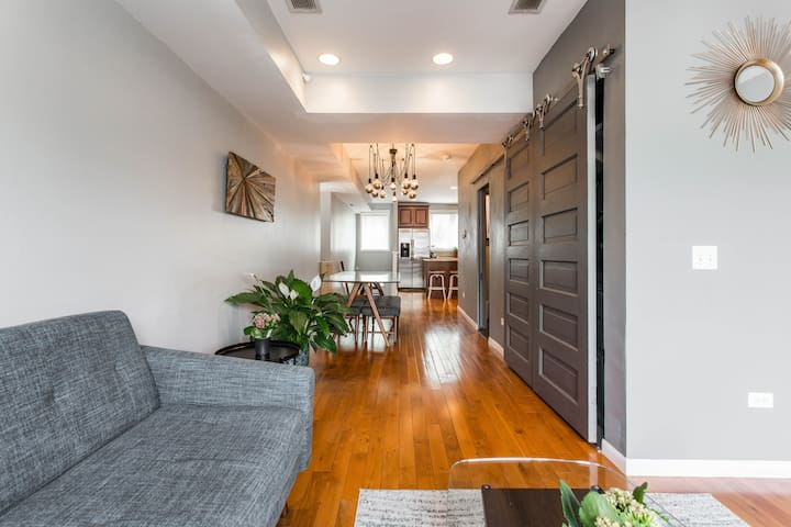 The light runs straight through the living and dining area with unique features like the antique sliding doors and custom half bath