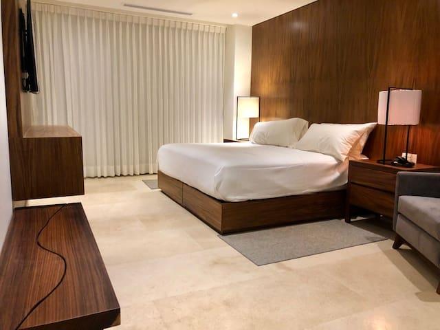 Designer lighting, cozy up in this master suite