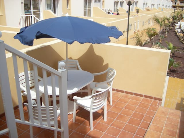 Private gated Patio area with Pool View