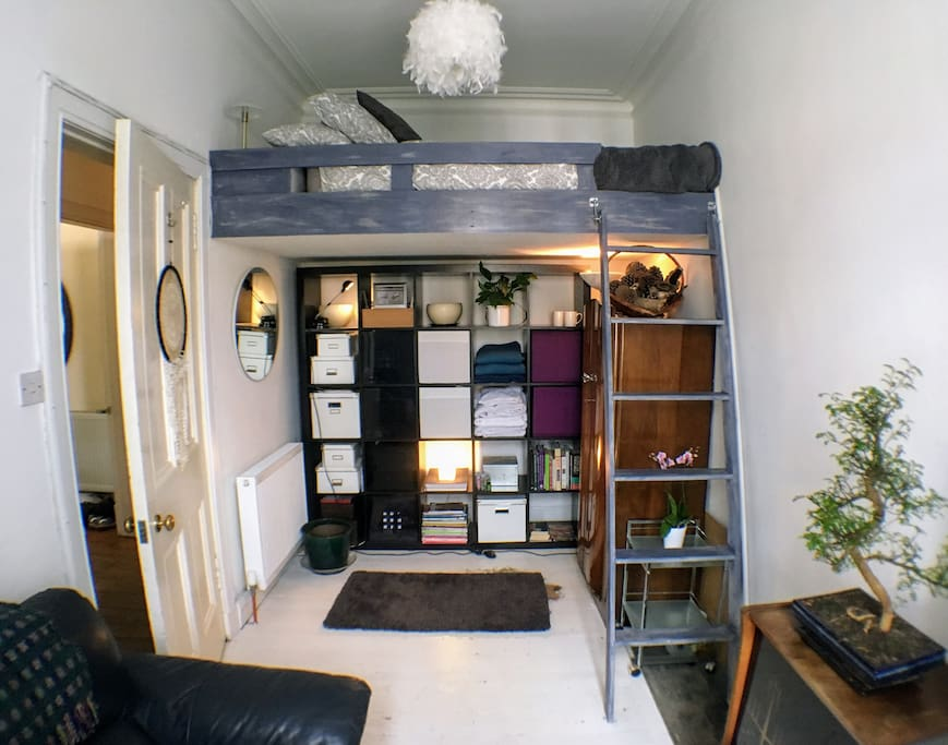 Cosy bedroom with Double Platform Bed and Living Area with Sofa