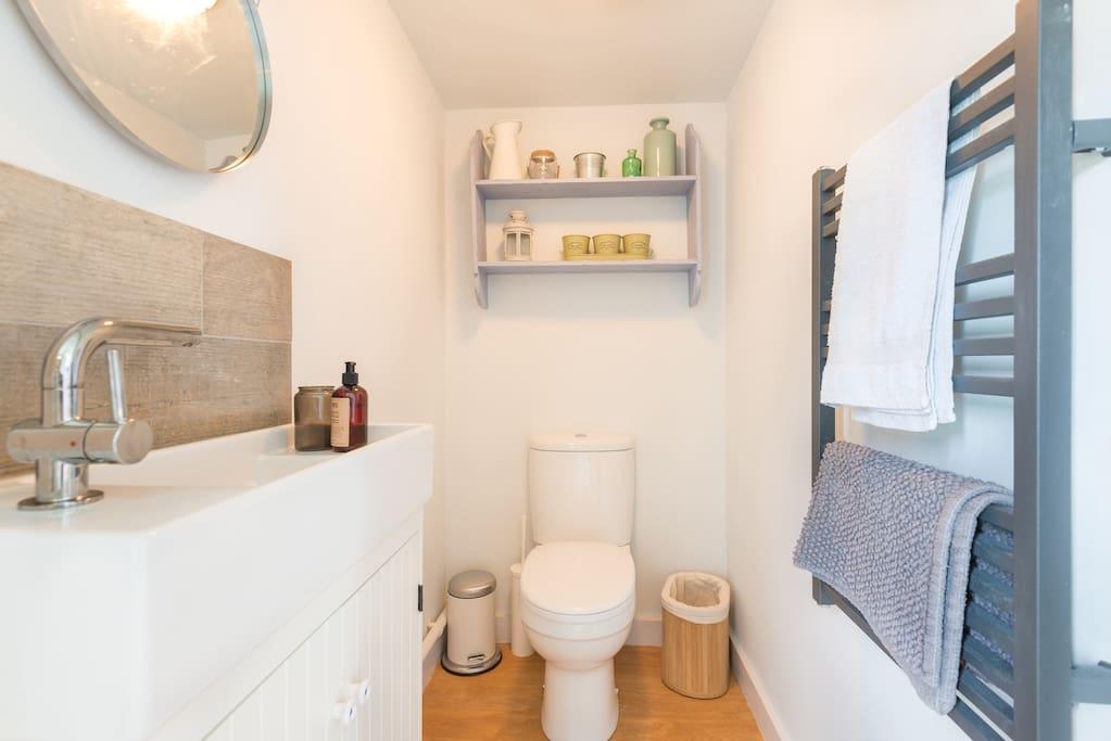 Stylish bathroom with heated towel rail