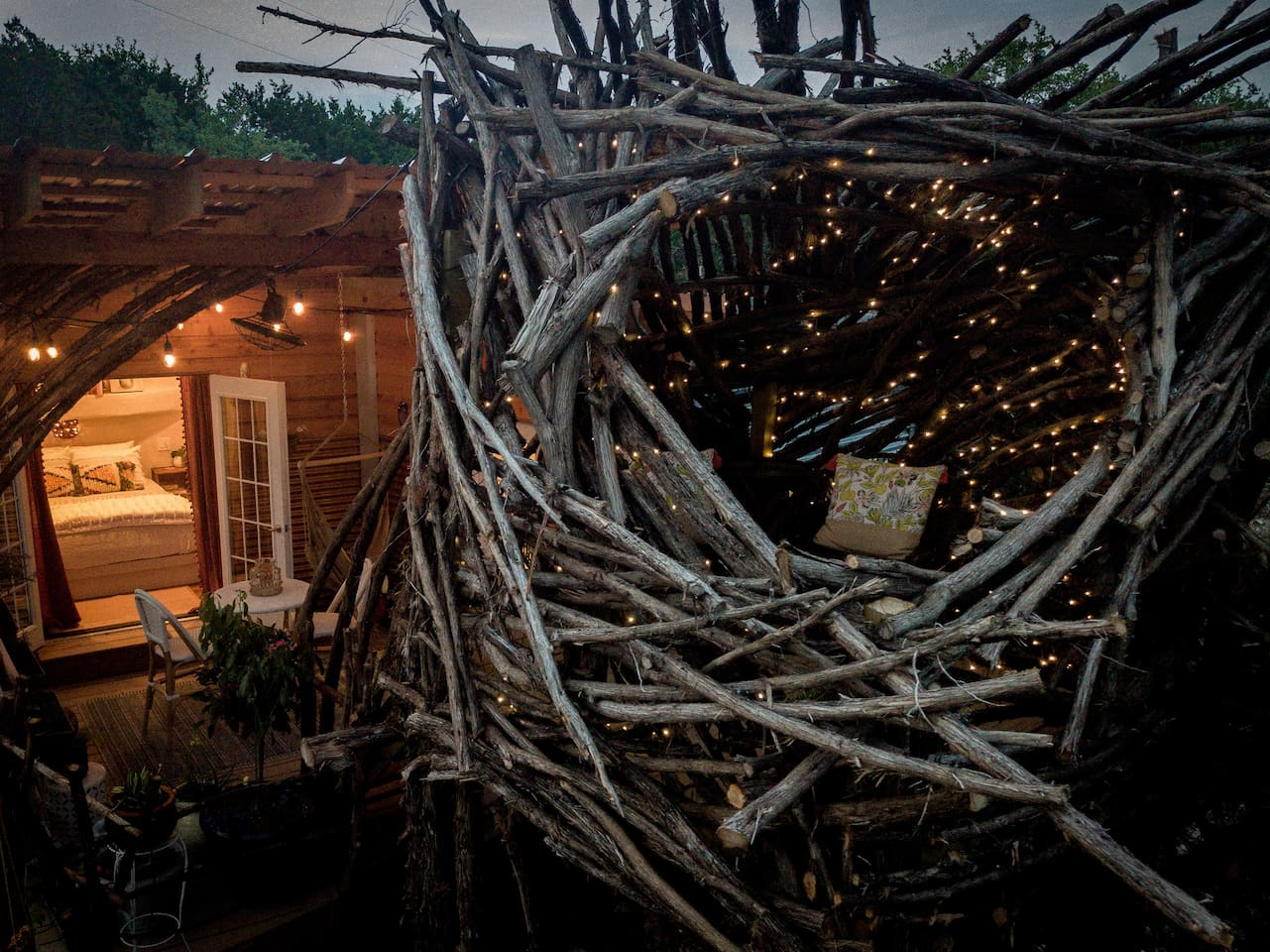 Climb into the nest tower from your secluded patio