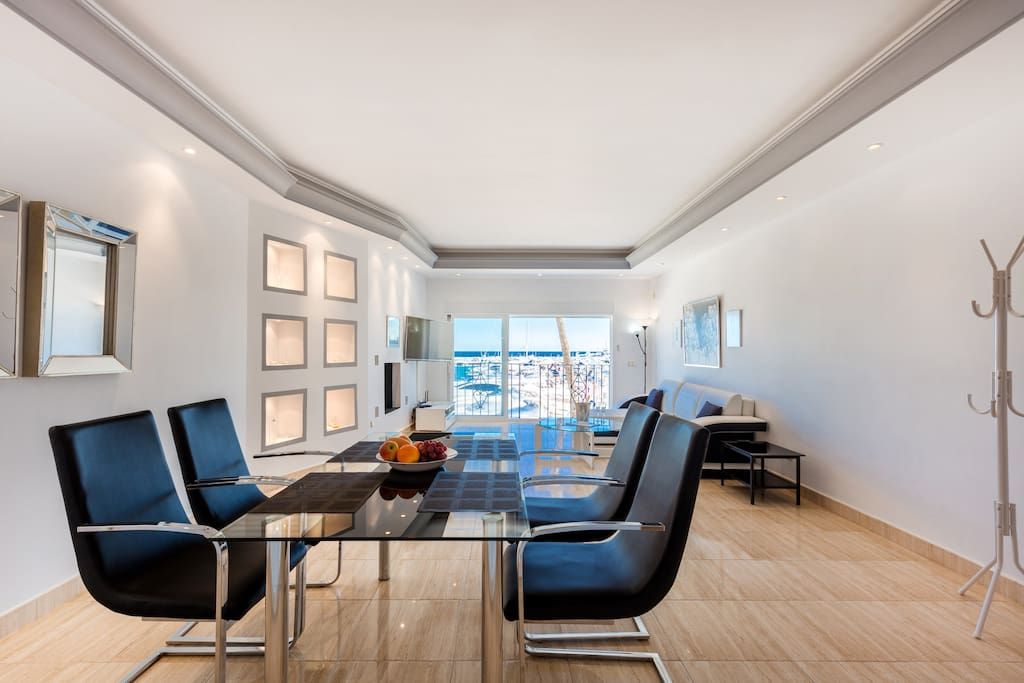 Large and bright dining room with sea and port views