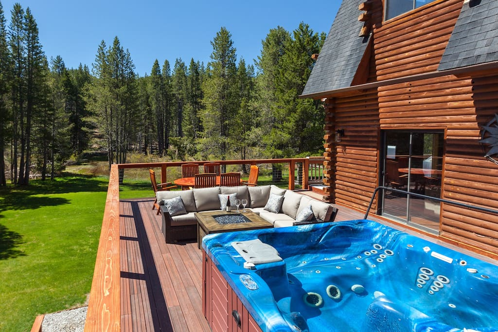 Beautiful and secluded 600 ft. deck with hot tub, fire pit, and patio furniture