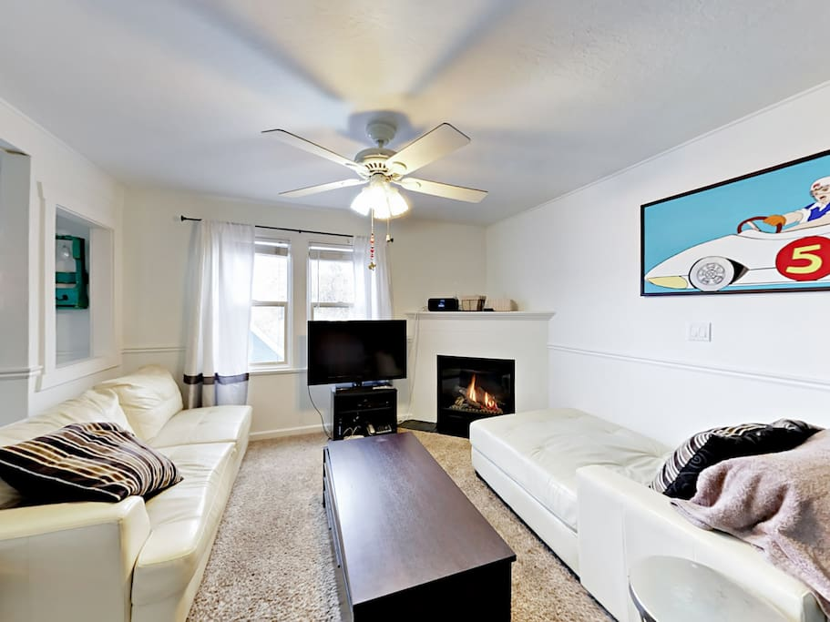 The living room is light and airy with plenty of room to sit.