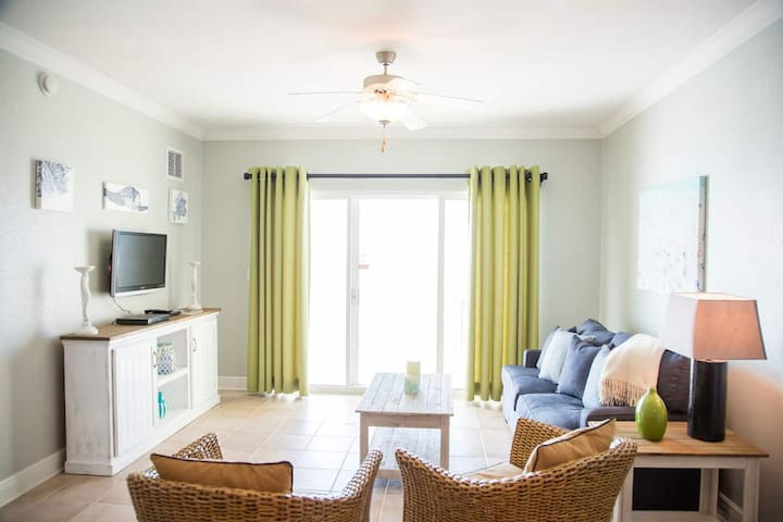 Gulf view just outside on the balcony. Queen size Sofa sleeping 2 adults or 3 children