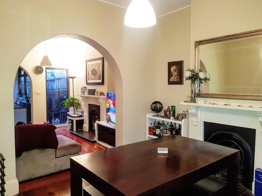 A wonderful homely feel with a lovely dining area with wooden table.