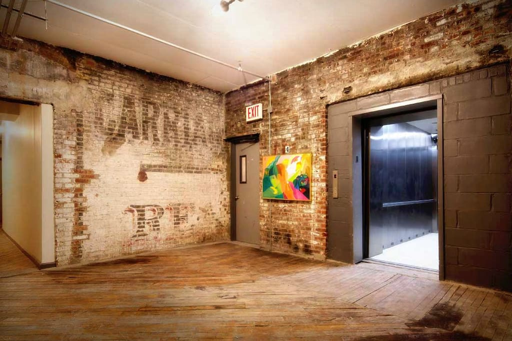 The interior of the building of the 4th floor! Beautiful brick and old signage