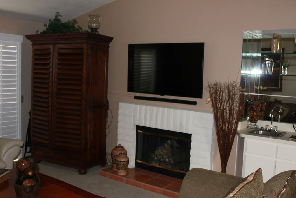 Entertainment center with 54 inch Smart TV with Blue Ray player.