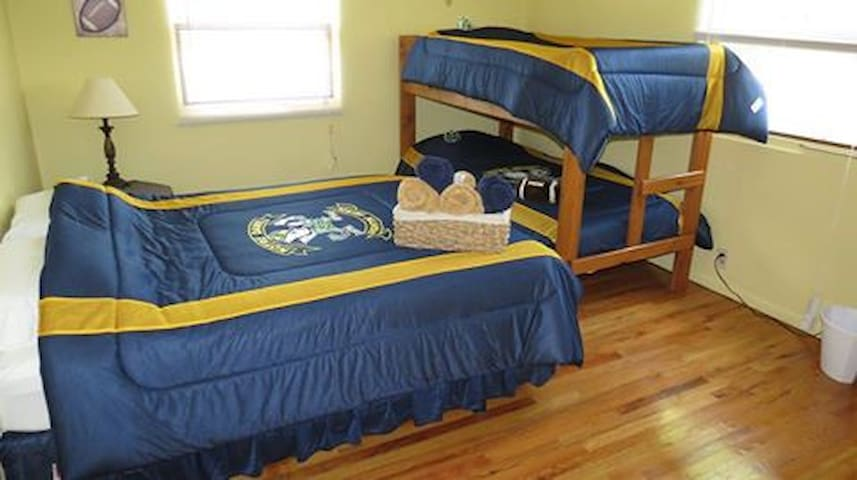 This is the Football Room.  It has a queen bed and a set of twin bunk beds.  The room can sleep up to 4 people.