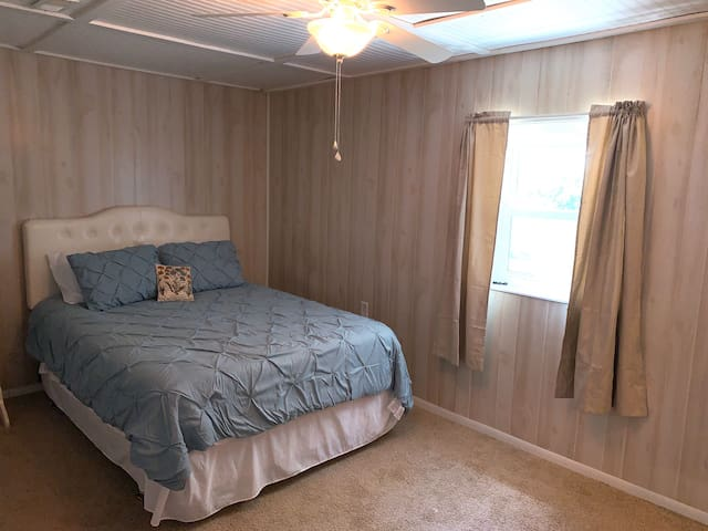 Guest bedroom with queen bed, lakeview, basement level