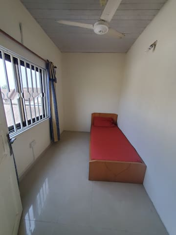 Second bedroom with single bed.