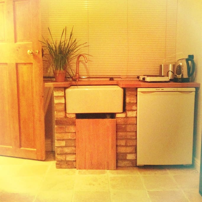 Kitchenette, includes a fridge-freezer and double hob