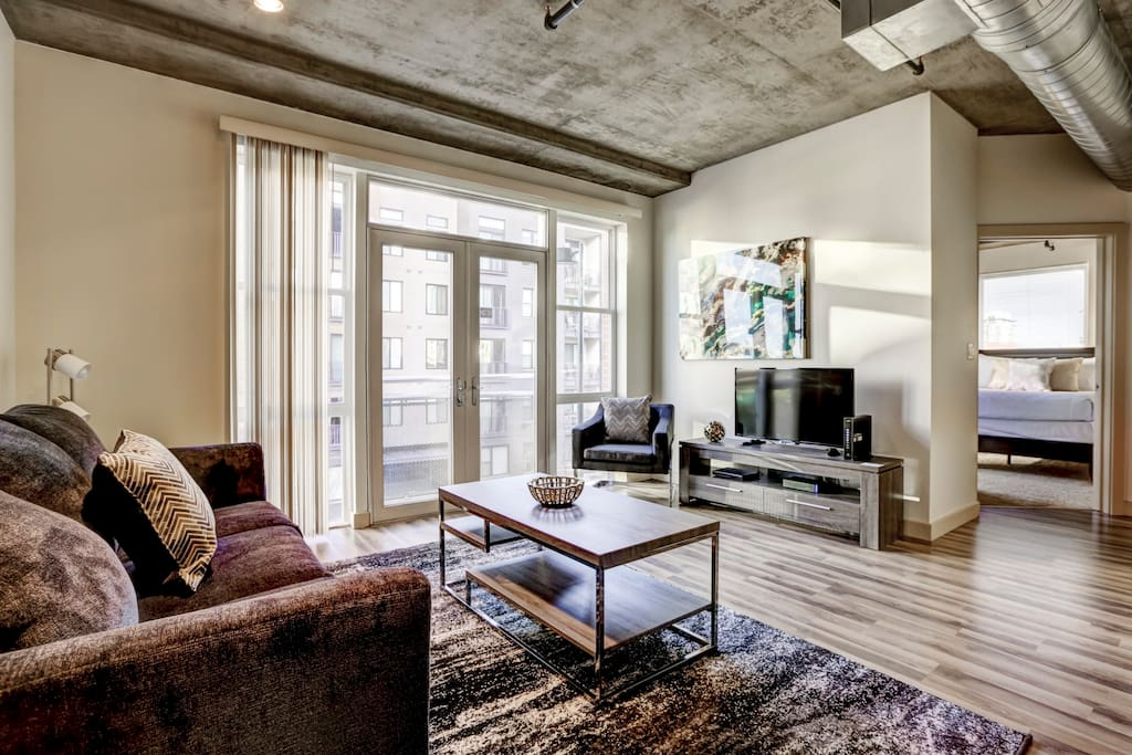 Living Room at Premier Lofts by Stay Alfred
