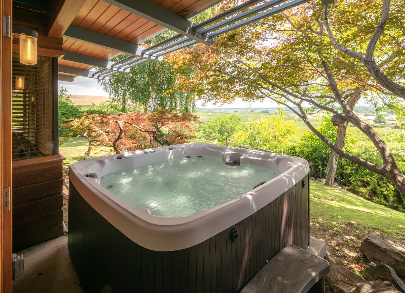 Private outdoor hot tub with views of the valley