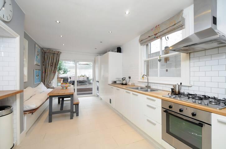 Kitchen with doors to garden, underfloor heating SMEG fridge.