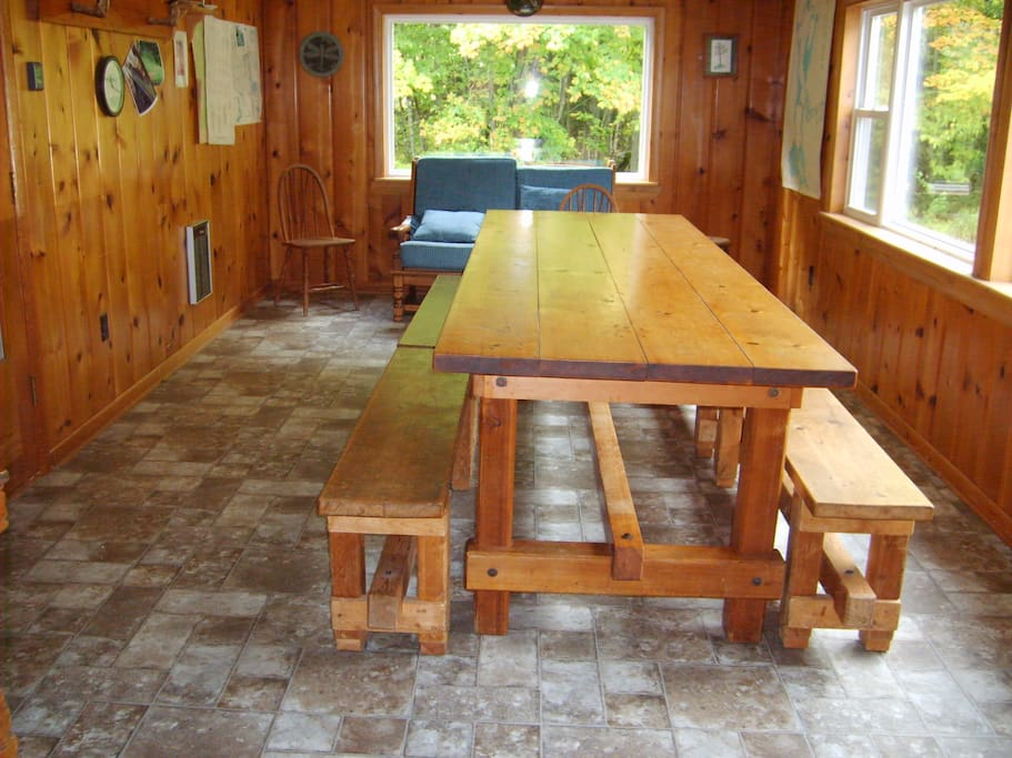Dining room with one of a kind table with benches.  Seats up to 12 people.