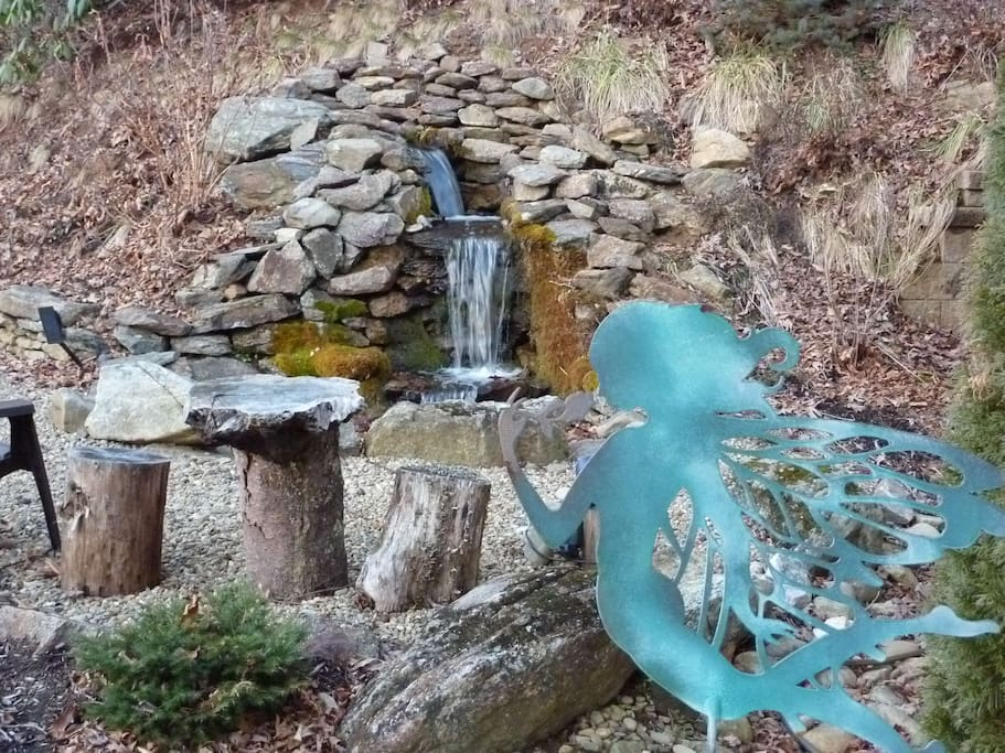 water fall area with fire pit