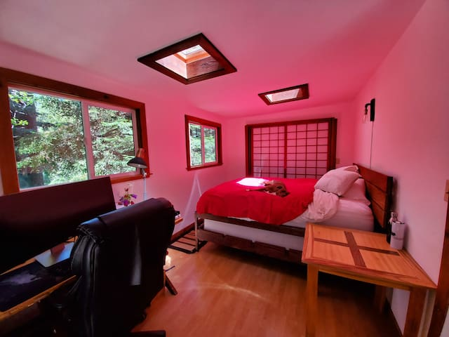 Queen bed with a view in the canopy.  I made the table!