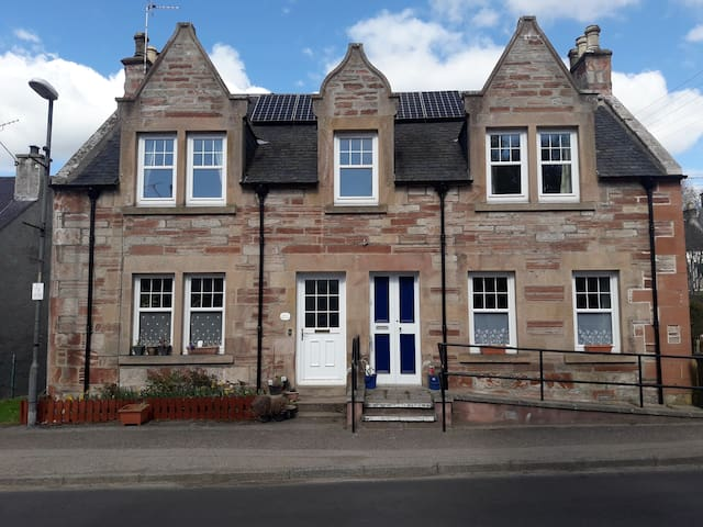 Large old village Royal Bank House.