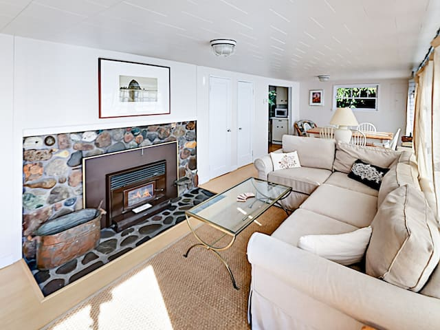Enjoy the allure of a wood-burning fireplace in the living room.
