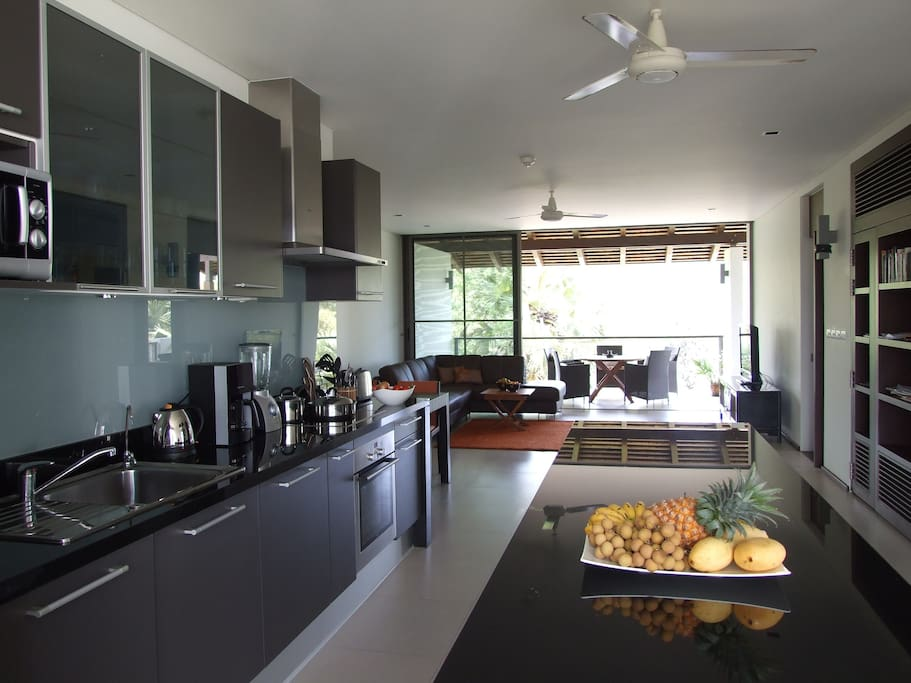 Modern well-equipped kitchen with dishwasher and Nespresso machine