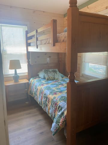 Small room with bunk beds.