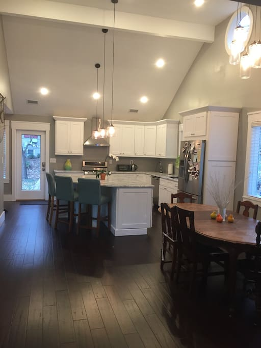 Open Modern Kitchen and Dining Area. Kitchen is fully equipped.