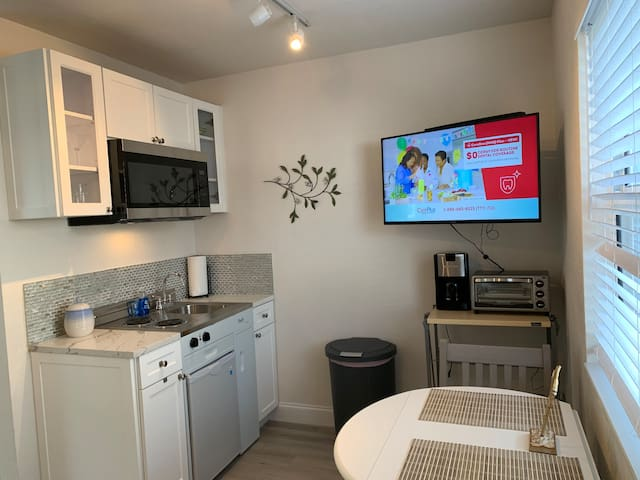 Kitchenette includes microwave, 2 burner stove, mini-fridge, toaster oven, coffee maker and seating for 2!  Dishes,  flatware and basic cooking supplies included.