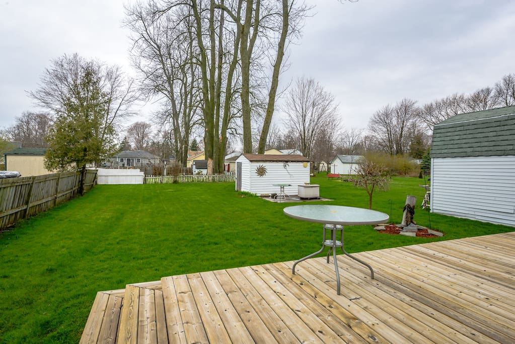 Spacious patio area opens to expansive back yard