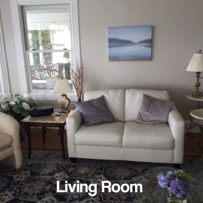 The  living room is bright and comfortable with windows overlooking the waters of Long Island Sound
