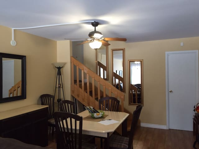 View of dining area and entrance stairs to living area in 1001