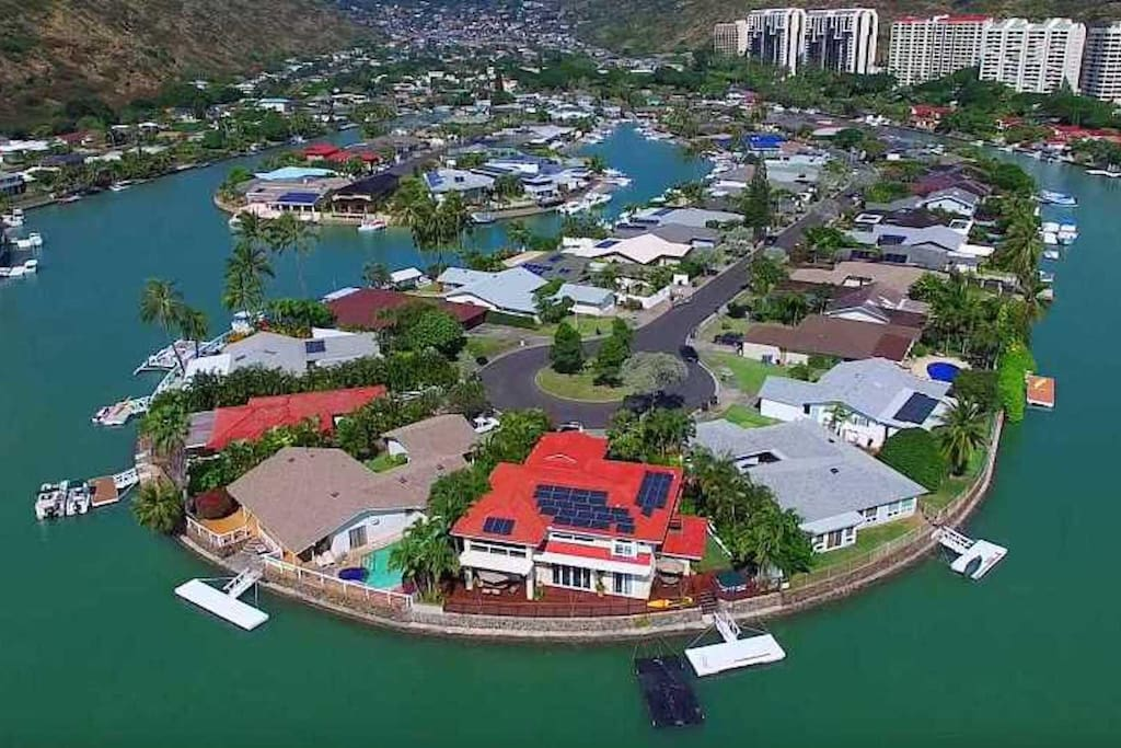 Aerial View of Our Home Located on Right Side Of Point With Dark Blue Pool