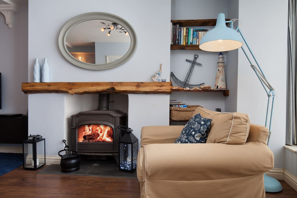 Real log burner at The Hideaway - a cosy pet friendly ground floor apartment in the centre of Shaldon