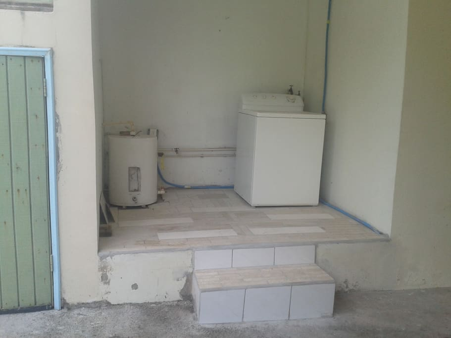 Exclusive laundry area to apartment. Tiles laid by me.
