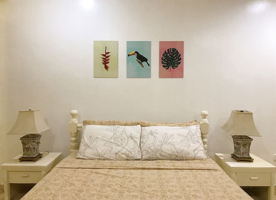 Tropical Artwork by Leandro.  The colors bring the room together and give it that easy breezy vibe