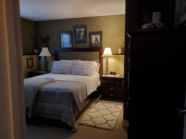 Super cozy bedroom, plenty drawer and closet space. TV with streaming and an air purifier.