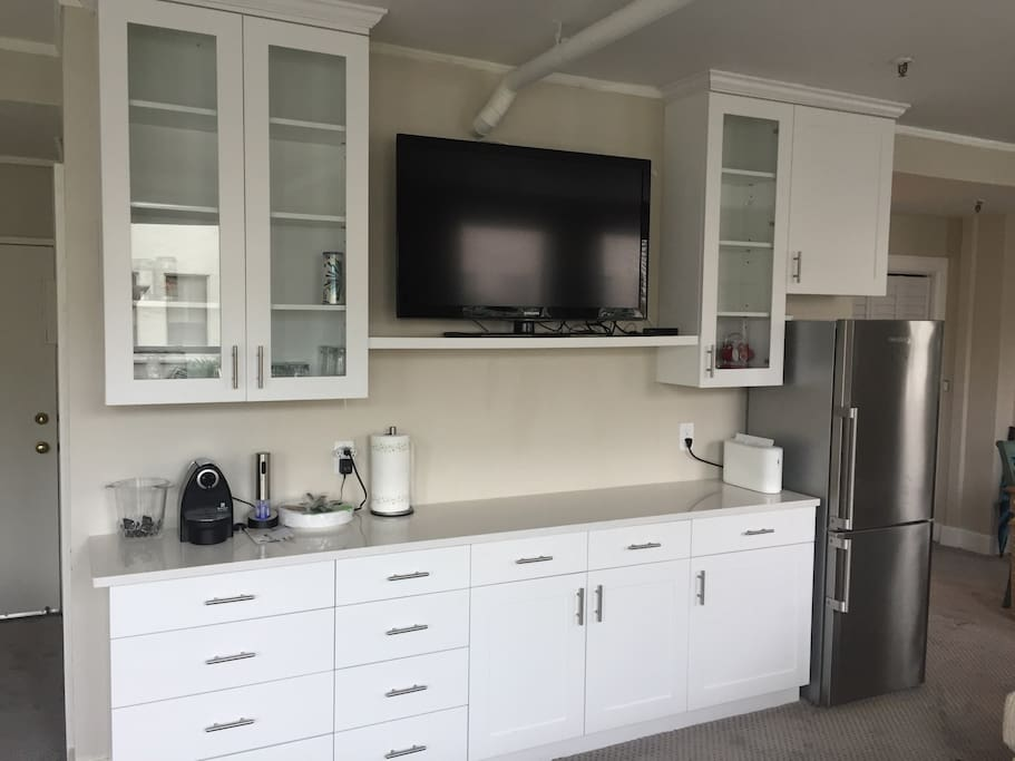 Open kitchen area, full fridge with plenty of storage.