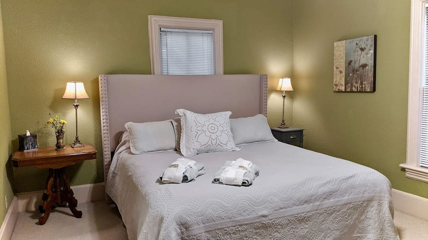 The master bedroom is  cozy and perfect for getting a good night's rest.
