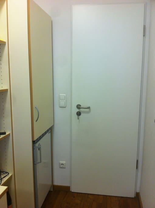 The refrigerador is inside the room