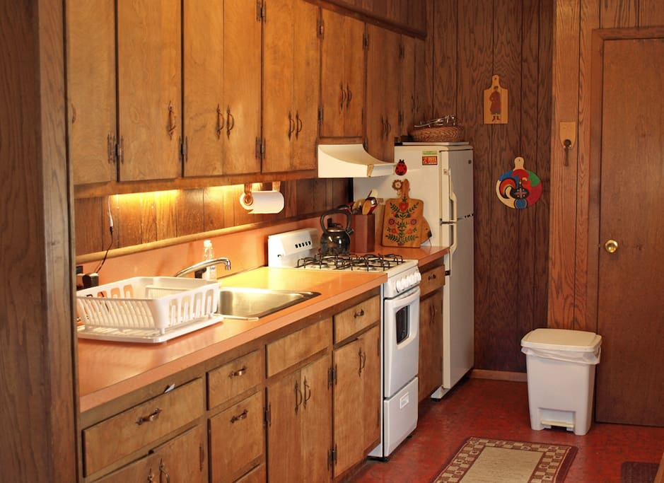 The kitchen's equipped with a gas stove, toaster over and microwave.